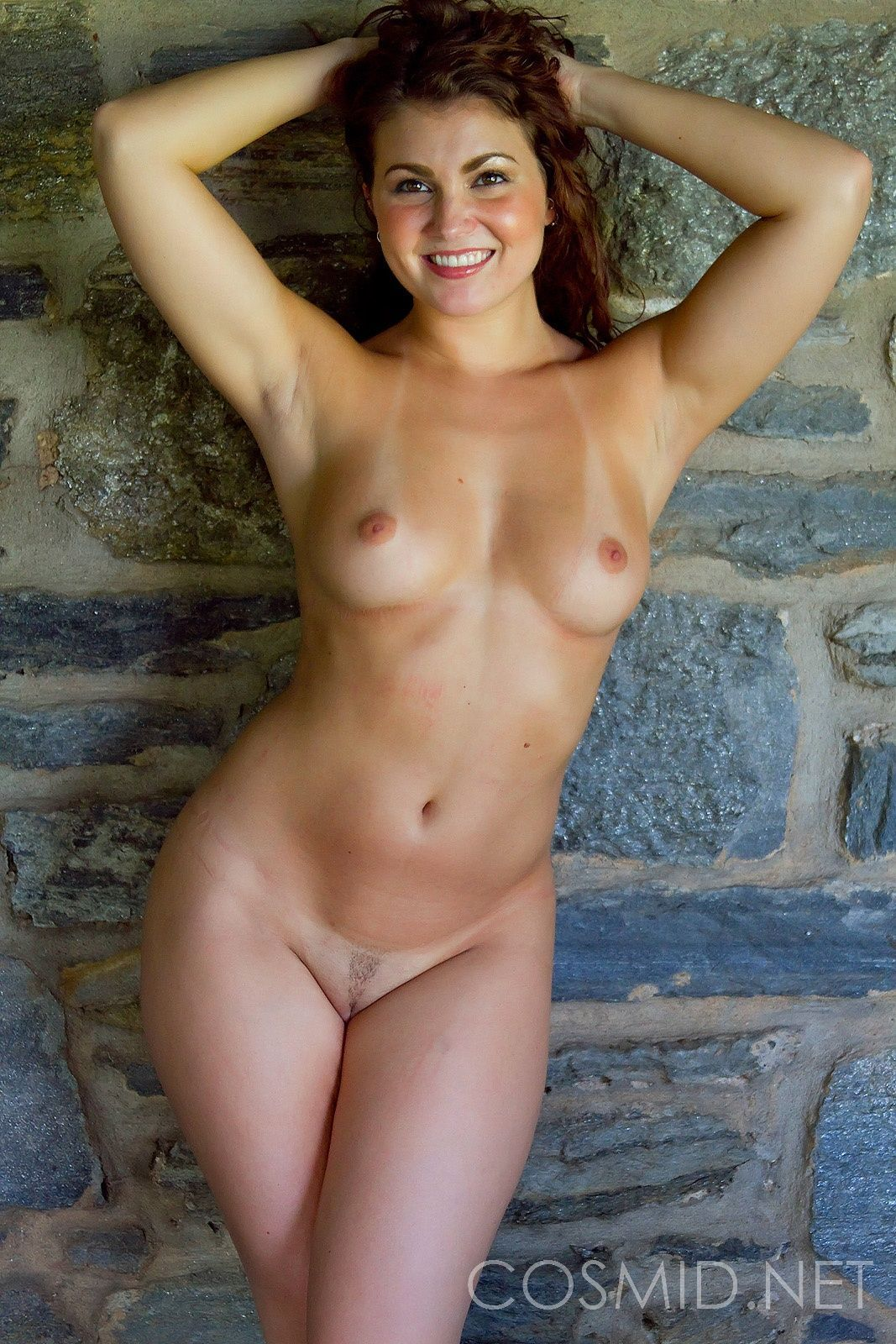 Hanging upside down nude