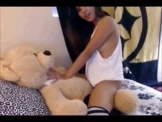 Girl with teddy bear strapon