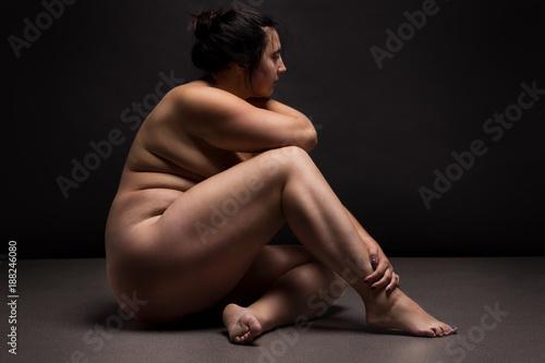 Nude women doing yoga