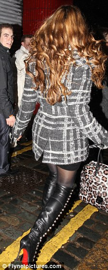 Kelly brook breaks out her favourite thigh high dominatrix