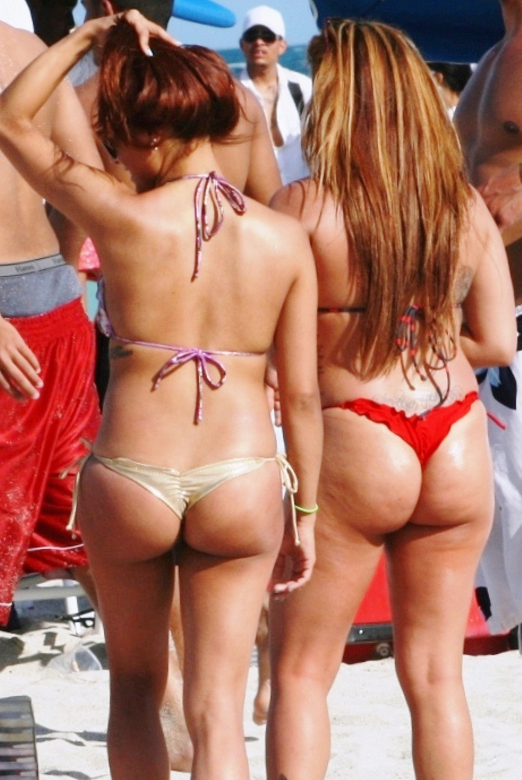Amazing candid girl sunbathing wearing a tiny thong bikini