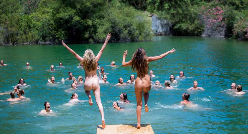 Hanging upside down nude
