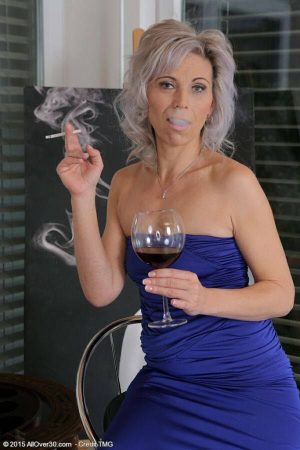 Super sexy old spunker has a smoke and plays with her
