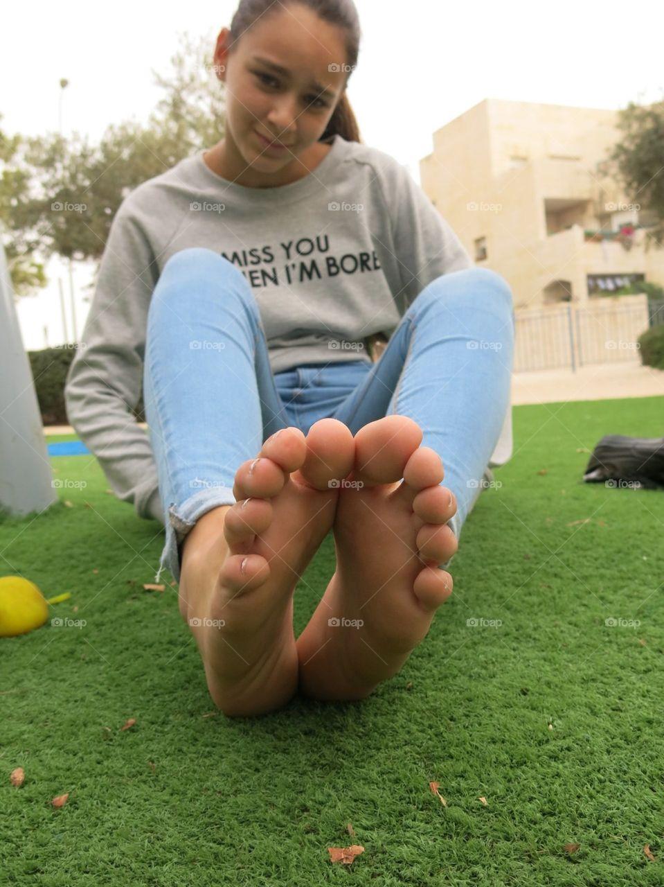 Teen girl feet soles